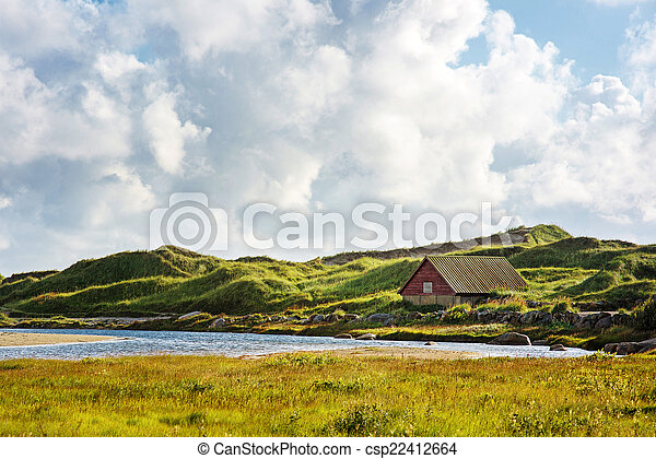 Norwegian landscape with small house - csp22412664