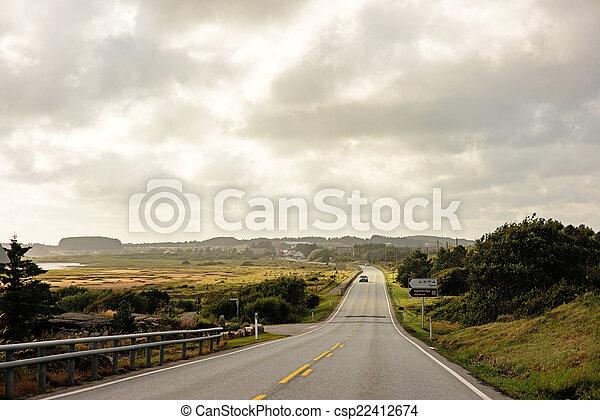 Norwegian road in the evening sun - csp22412674