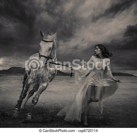 Nostalgic young brunette posing next to a horse - csp6720114