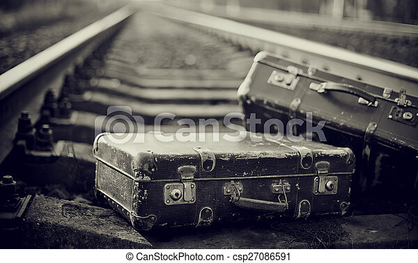 Not the color image of forgotten suitcases on rails. - csp27086591