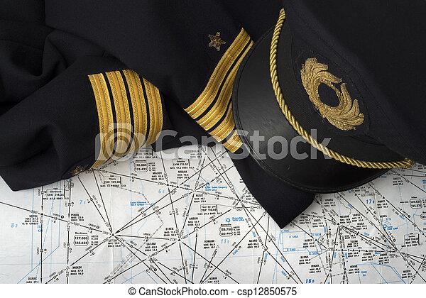 not worn captain uniform over an aeronautical navigation chart - csp12850575