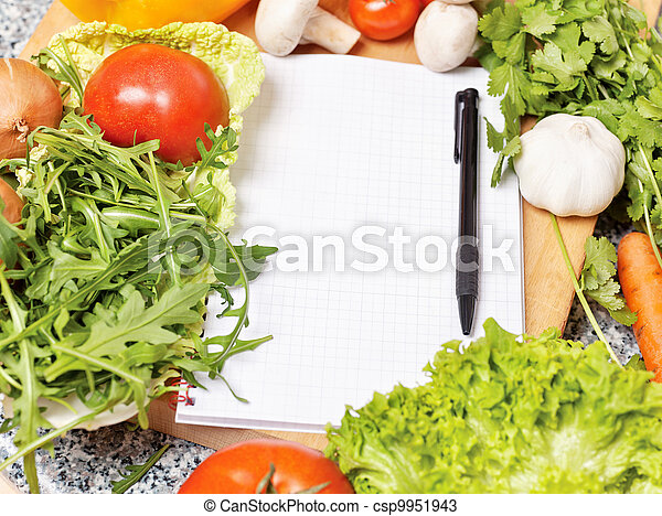 Note book among the vegetables  - csp9951943