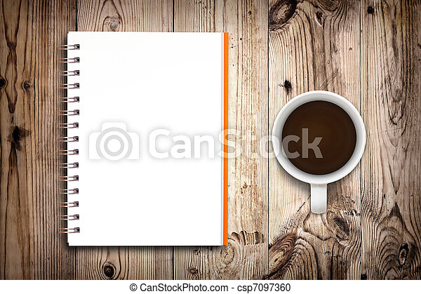 Notebook and coffee cup isolated on wooden background - csp7097360
