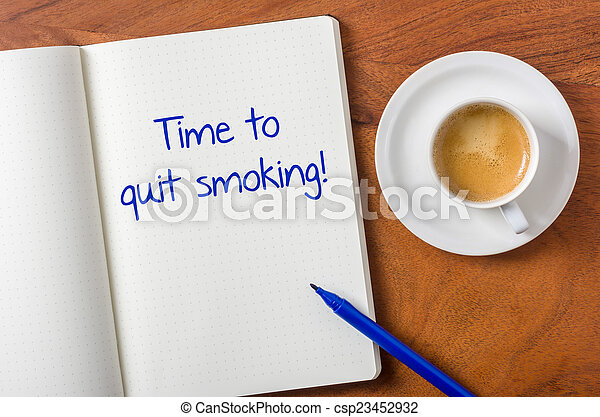 Notebook on a desk - Time to quit smoking - csp23452932