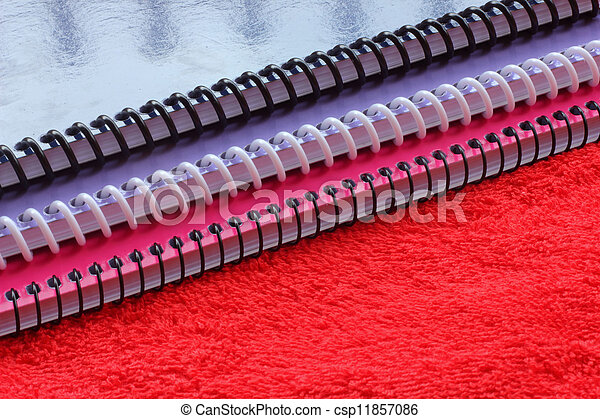 Notebook on a red cloth - csp11857086