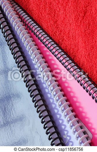 Notebook on a red cloth - csp11856756