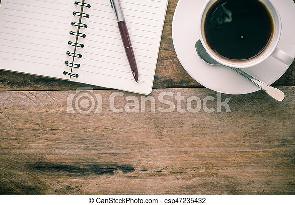 Notebook pen and cup of coffee on wood - csp47235432