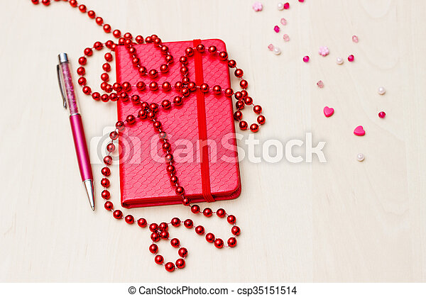 Notebook with flower on wooden - csp35151514