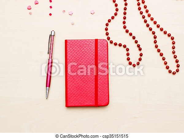 Notebook with flower on wooden - csp35151515
