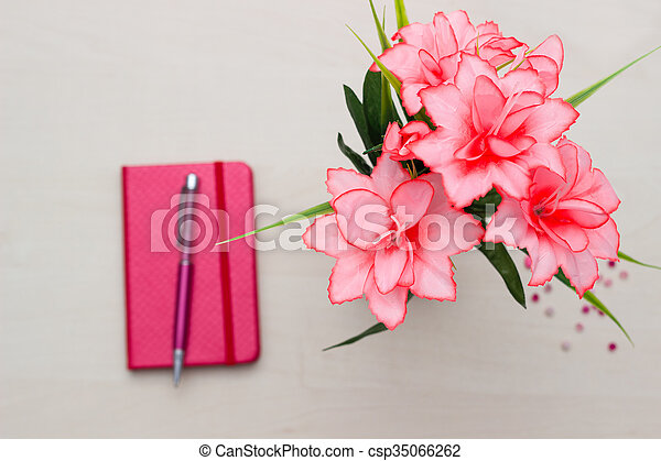 Notebook with flower on wooden - csp35066262