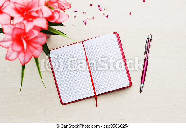 Notebook with flower on wooden - csp35066254