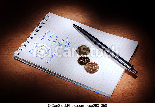 Notebook with pen and coins in the dark - csp2931350