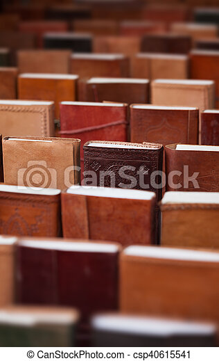notebooks in leather covers in a souvenir shop - csp40615541