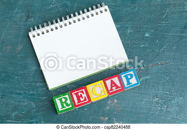 Notepad on wooden table and wood alphabet blocks - csp82240488
