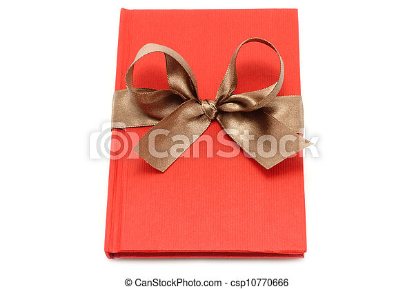 Notepad with brown bow on a white background - csp10770666