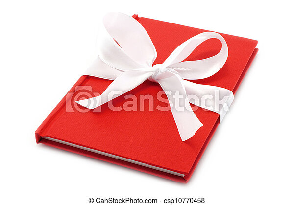 Notepad with white bow on a white background - csp10770458