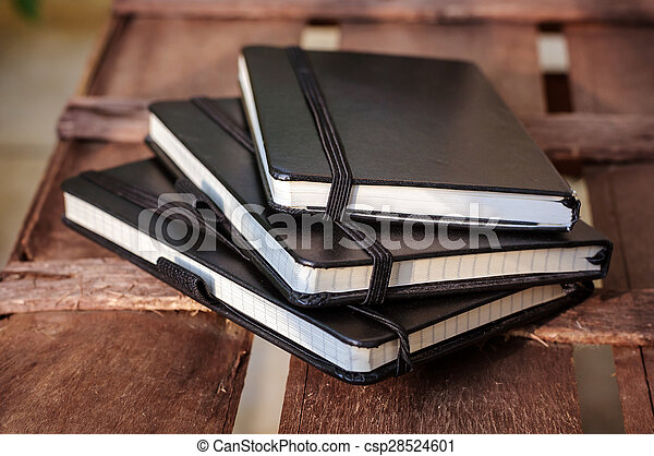 notepads on brown wood table - csp28524601