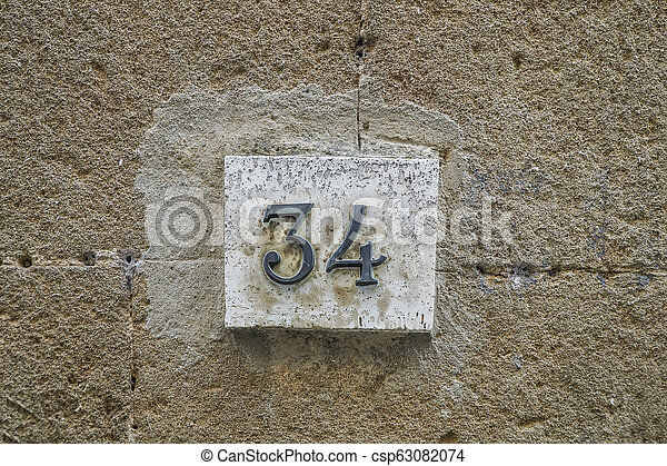 number thirty four on a wall - csp63082074