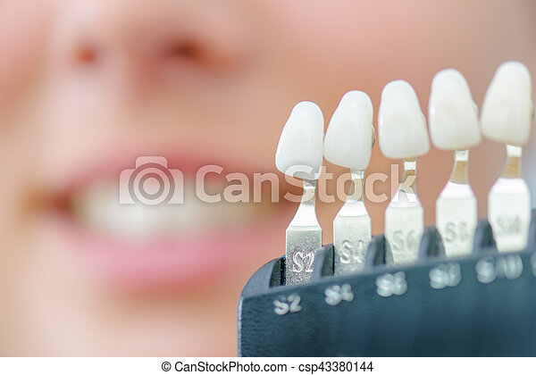 Numbered individual false teeth for colour match - csp43380144