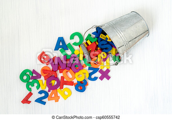 Numbers and letters falling from bucket - csp60555742