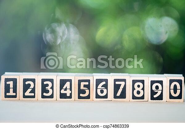 Numbers of wood blocks begin 1 to 0. - csp74863339