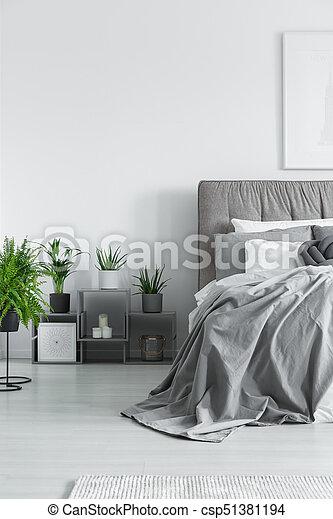 Numerous plants in bedroom - csp51381194