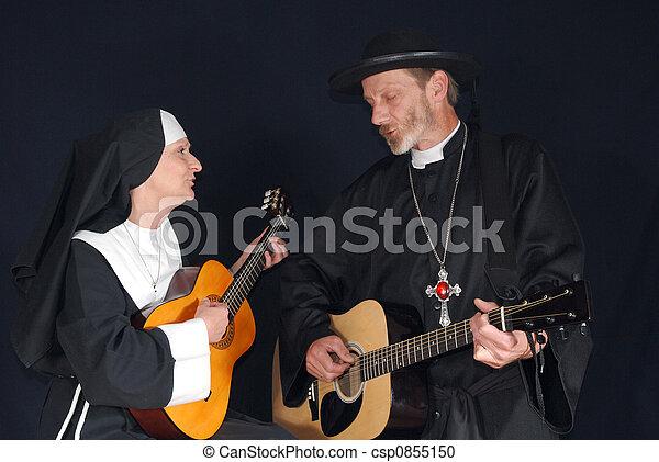 Nun and priest singing - csp0855150