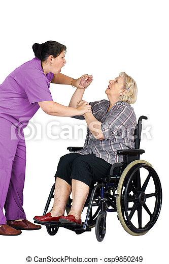 Nurse assaulting senior woman in wheelchair - csp9850249