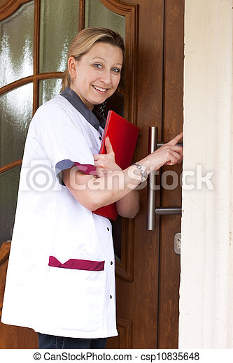 nurse at the door for home visit - csp10835648