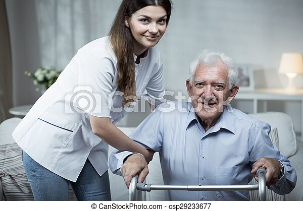 Nurse helping disabled senior man - csp29233677