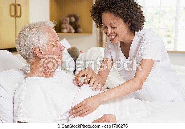 Nurse Helping Senior Man - csp1706276