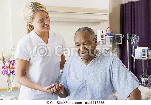 Nurse Helping Senior Man To Walk - csp1718555