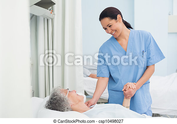 Nurse holding the hand of a patient - csp10498027