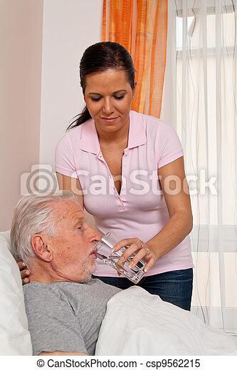 nurse in aged care for the elderly in altenhei - csp9562215