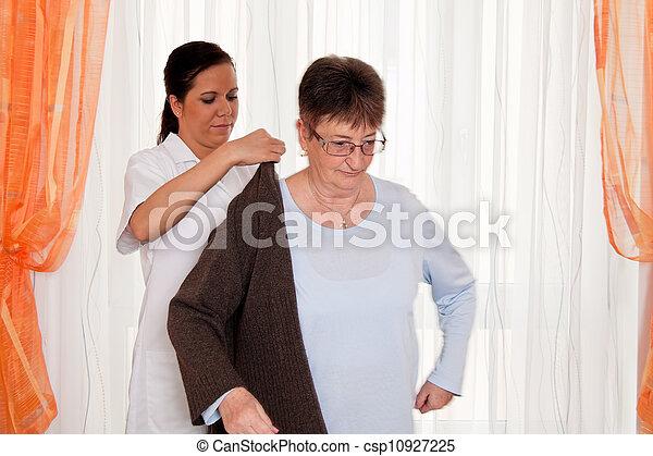 nurse in elderly care for the elderly in nursing homes - csp10927225