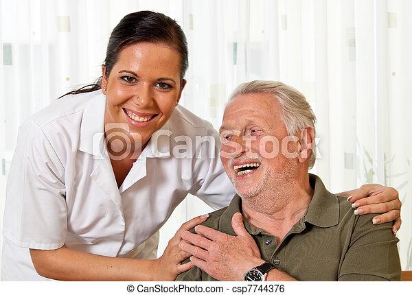 nurse in elderly care for the elderly - csp7744376