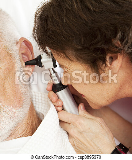 Nurse or Doctor Using Otoscope - csp3895370