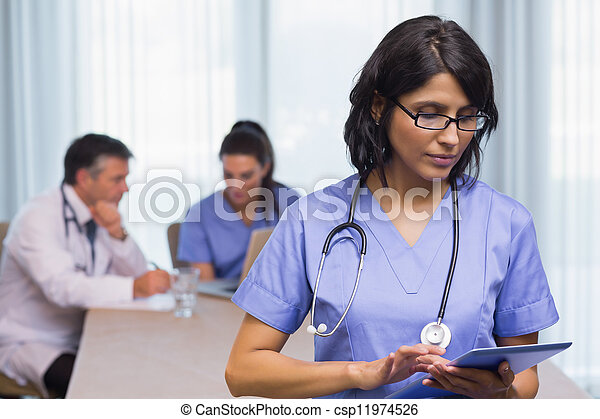 Nurse using digital tablet - csp11974526