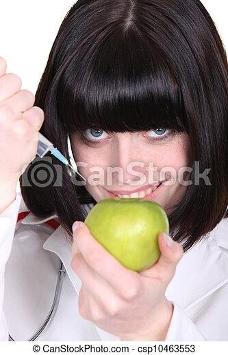Nurse using syringe - csp10463553