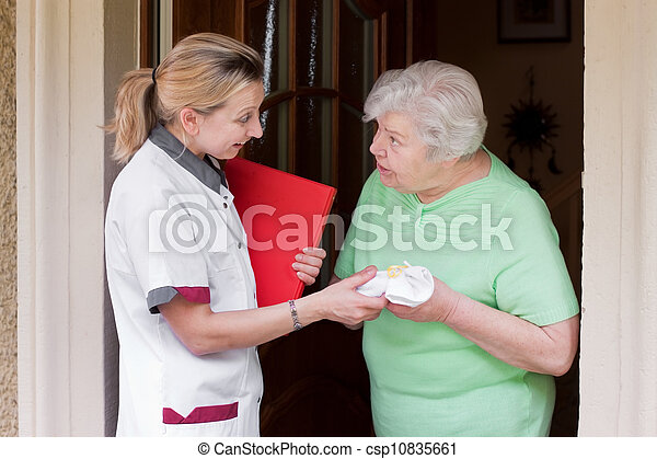 nurse visiting a patient at home - csp10835661