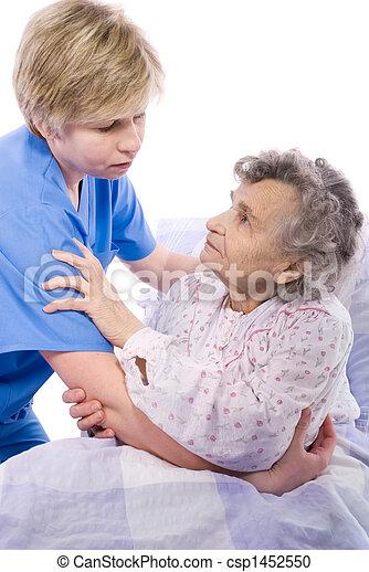 nurse with a senior woman - csp1452550