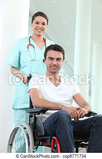 Nurse with disabled man in a wheelchair - csp8771734