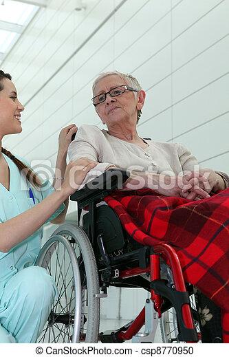 Nurse with elderly woman in wheelchair - csp8770950