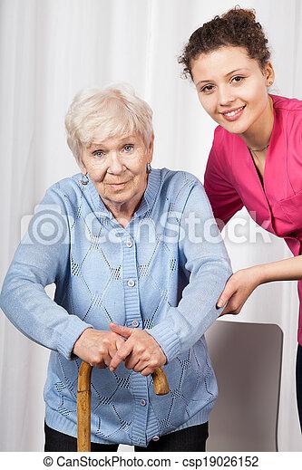 Nurse with elderly woman - csp19026152