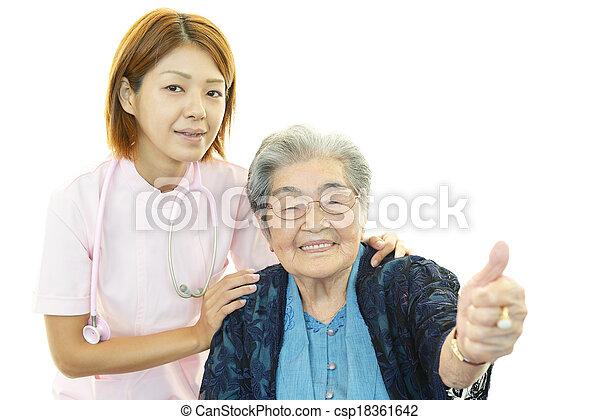 Nurse with elderly woman - csp18361642