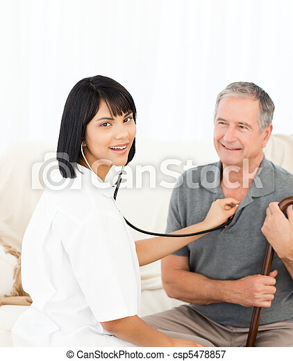 Nurse with her patient looking at the camera - csp5478857