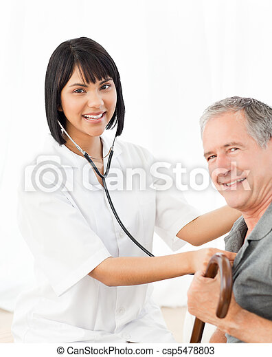 Nurse with her patient looking at the camera - csp5478803