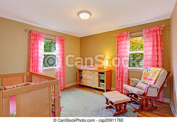 Nursery room with pink ruffle curtains - csp20911760