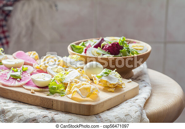 Nutritious cereal breads with cream cheese and salad. - csp56471097