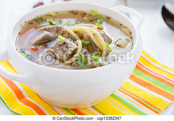 nutritious meat soup in a white tureen - csp13382347